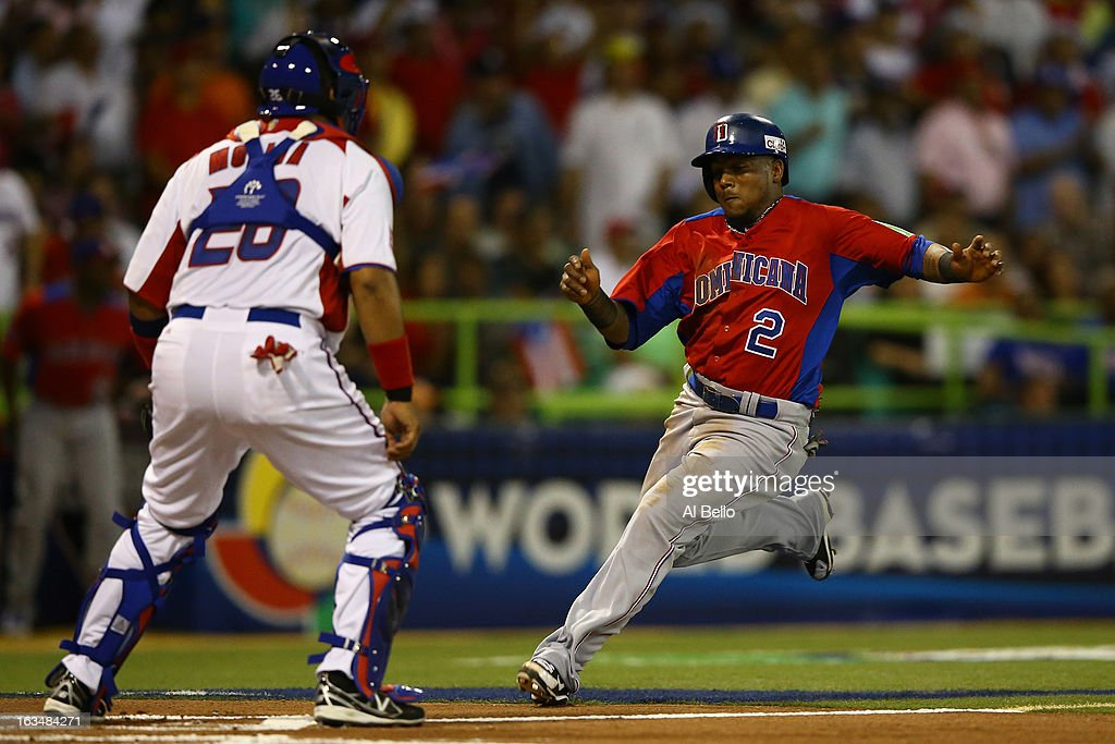 Erick Aybar #2 of the Dominican Republic slides into home against Jose Molina #28 of Puerto Rico during the first round of the World Baseball Classic at Hiram Bithorn Stadium on March 10, 2013 in San Juan, Puerto Rico.