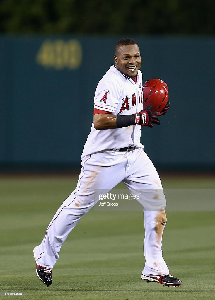 Erick Aybar #2 of the Los Angeles Angels of Anaheim celebrates his walk off single against the St. Louis Cardinals in the ninth inning at Angel Stadium of Anaheim on July 4, 2013 in Anaheim, California. The Angels defeated the Cardinals 6-5.