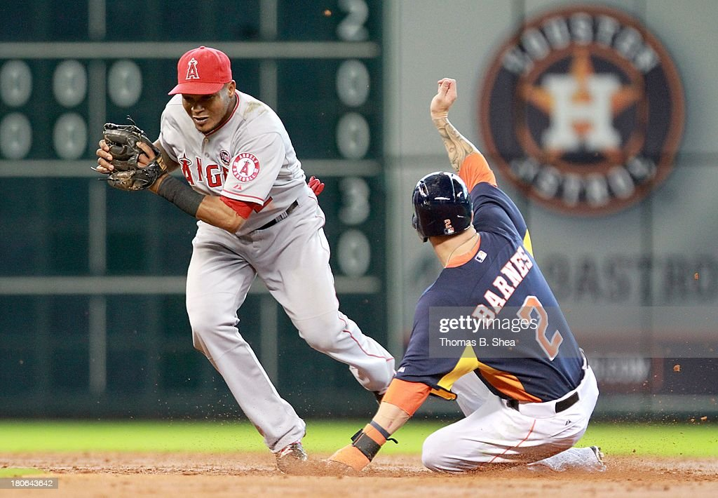 Erick Aybar #2 of the Los Angeles Angels of Anaheim forces out Brandon Barnes #2 of the Houston Astros at second base in the second inning on September 15, 2013 at Minute Maid Park in Houston, Texas.