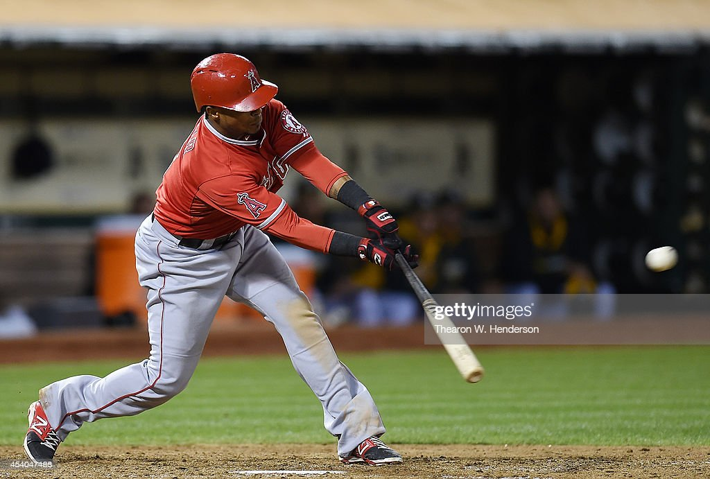 Erick Aybar #2 of the Los Angeles Angels of Anaheim hits an RBI single scoring Howie Kendrick #47 against the Oakland Athletics in the top of the seventh inning at O.co Coliseum on August 23, 2014 in Oakland, California.