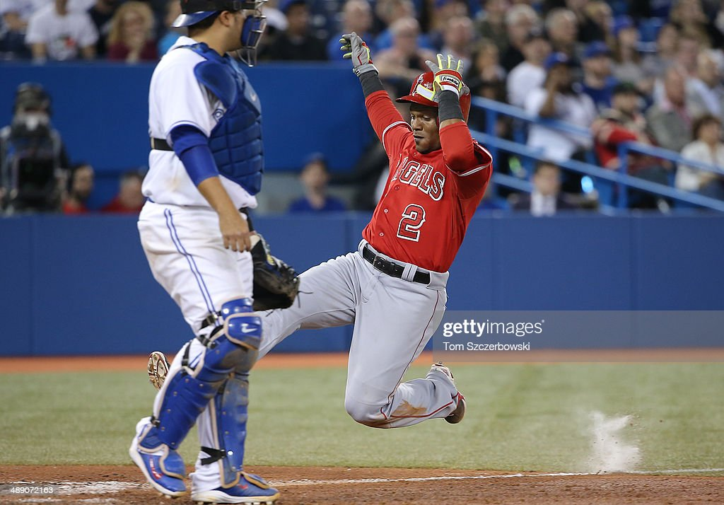 Erick Aybar #2 of the Los Angeles Angels of Anaheim scores a run on a sacrifice fly RBI in the ninth inning during MLB game action against the Toronto Blue Jays on May 9, 2014 at Rogers Centre in Toronto, Ontario, Canada.