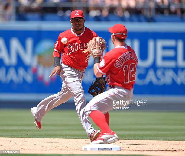 Erick Aybar of the Los Angeles Angels of Anaheim throws to Johnny Giavotella for the first out of a double play during the fifth inning of the game...