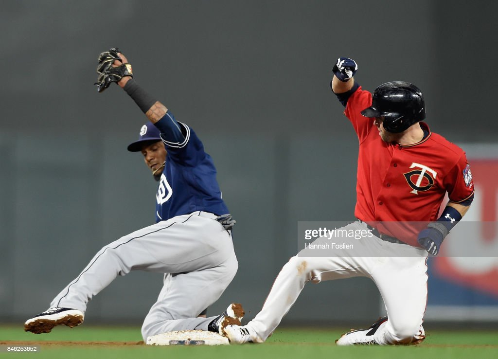 Erick Aybar #8 of the San Diego Padres forces out Brian Dozier #2 of the Minnesota Twins at second base during the fifth inning of the game on September 12, 2017 at Target Field in Minneapolis, Minnesota. The Twins defeated the Padres 16-0.