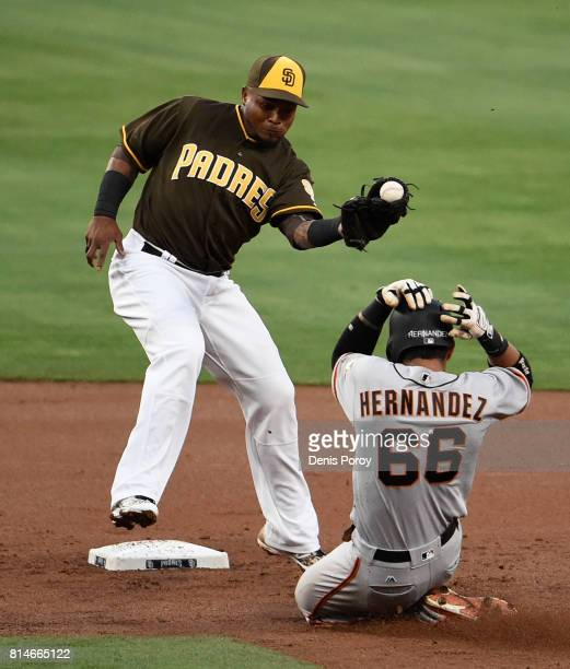 Erick Aybar of the San Diego Padres loses the ball as Gorkys Hernandez of the San Francisco Giants steals second base during the second inning of a...