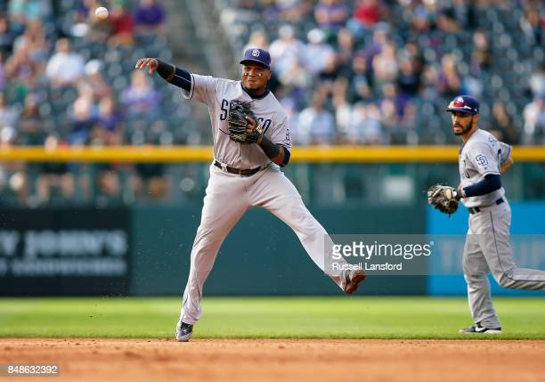 Erick Aybar of the San Diego Padres makes a play on a ground ball in the eighth inning of a regular season MLB game between the Colorado Rockies and...