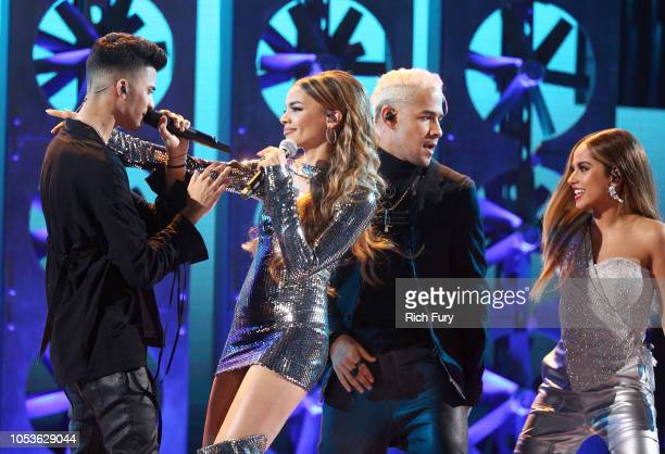 Erick Brian Colon of CNCO, Leslie Grace, Richard Camacho of CNCO, and Becky G perform onstage during the 2018 Latin American Music Awards at Dolby...