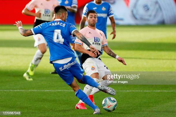 Erick Cabaco of FC Getafe and Adrian Embarba of Espanyol Barcelona battle for the ball during the Liga match between Getafe CF and RCD Espanyol at...