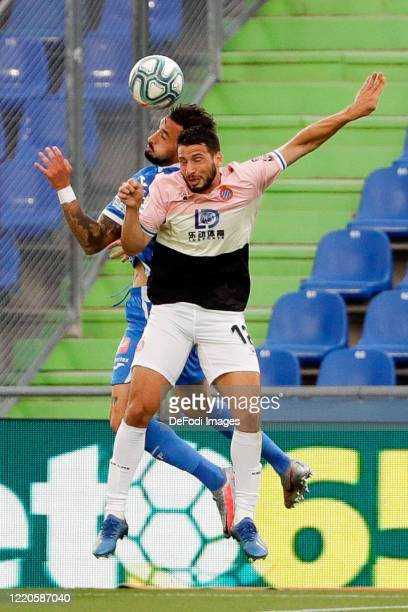 Erick Cabaco of FC Getafe and Jonathan Calleri of Espanyol Barcelona battle for the ball during the Liga match between Getafe CF and RCD Espanyol at...