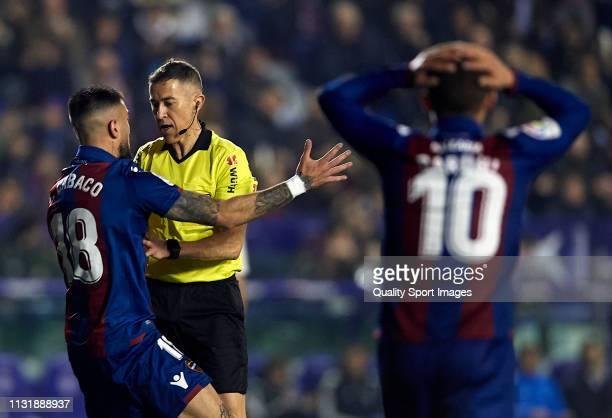 Erick Cabaco of Levante argues with Referee Ignacio Iglesias Villanueva during the La Liga match between Levante UD and Real Madrid CF at Ciutat de...