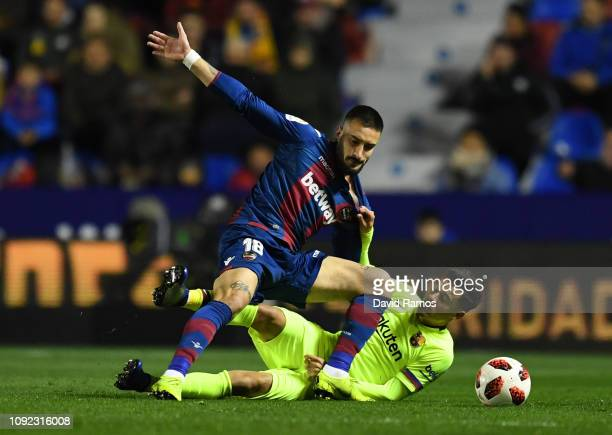 Erick Cabaco of Levante tangles with Philippe Coutinho of Barcelona during the Copa del Rey Round of 16 match between Levante and FC Barcelona at...