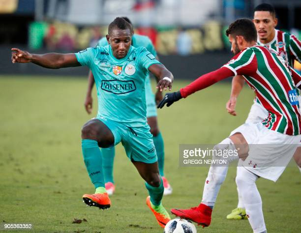 baf9439807 Erick Castillo from Barcelona SC of Ecuador challenges Jadson and Gilberto  of Brazilian club Fluminense for