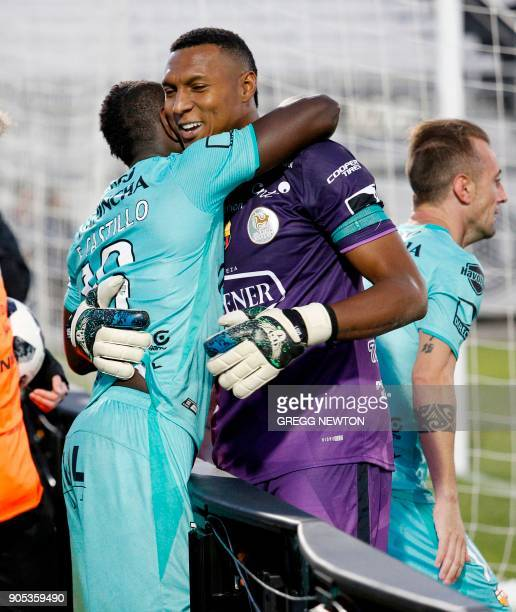 Erick Castillo from Barcelona SC of Ecuador is congratulated by goalkeeper Maximo Banguera after scoring the first of his two goals against Brazilian...