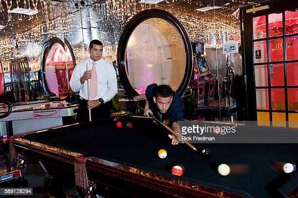 Erick Choez of Brooklyn and David Soriano of New York play pool as a reward for good behavior on Rewards Street inside Judge Rotenberg Center The...