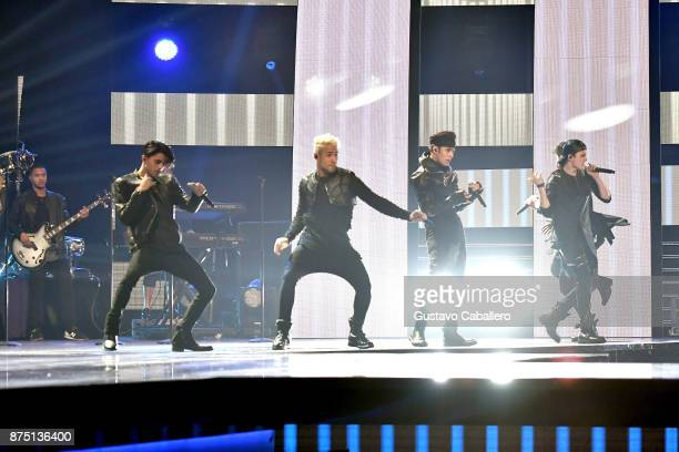 Erick Colon Richard Camacho Joel Pimentel and Christopher Velez of CNCO perform onstage during The 18th Annual Latin Grammy Awards at MGM Grand...