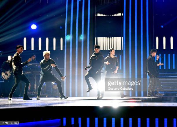 Erick Colon, Richard Camacho, Joel Pimentel, Christopher Velez, and Zabdiel De Jesus of CNCO perform onstage during The 18th Annual Latin Grammy...