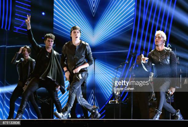 Erick Colon Zabdiel De Jesus Christopher Velez and Richard Camacho of CNCO perform onstage during The 18th Annual Latin Grammy Awards at MGM Grand...