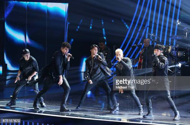 Erick Colon Zabdiel De Jesus Christopher Velez and Richard Camacho of CNCO perform onstage during the 18th Annual Latin Grammy Awards held at MGM...