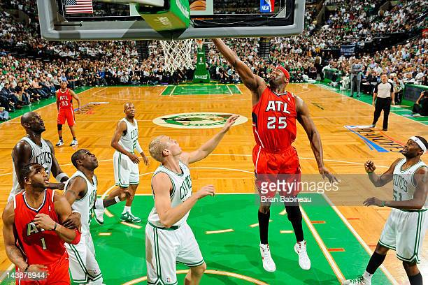 Erick Dampier of the Atlanta Hawks goes for a layup against Greg Stiemsma of the Boston Celtics in Game Three of the Eastern Conference Quarterfinals...