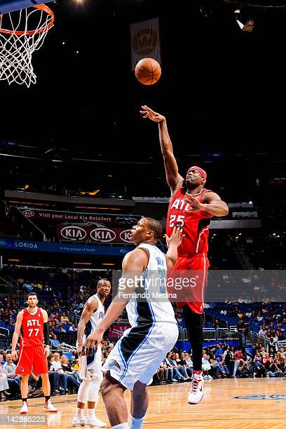 Erick Dampier of the Atlanta Hawks shoots against Daniel Orton of the Orlando Magic on April 13 2012 at Amway Center in Orlando Florida NOTE TO USER...