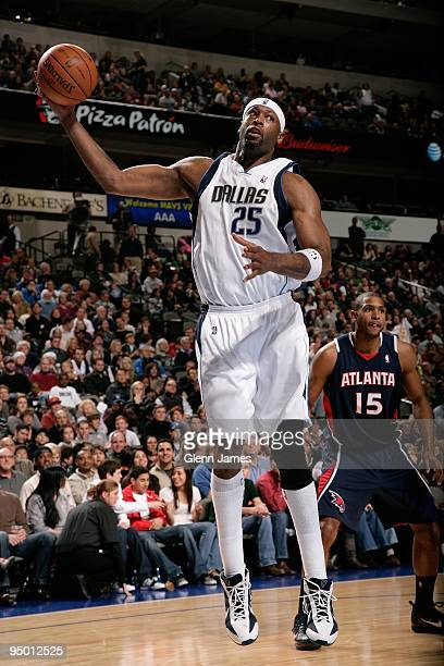 Erick Dampier of the Dallas Mavericks rebounds the ball against the Atlanta Hawks during the game on December 5 2009 at American Airlines Center in...