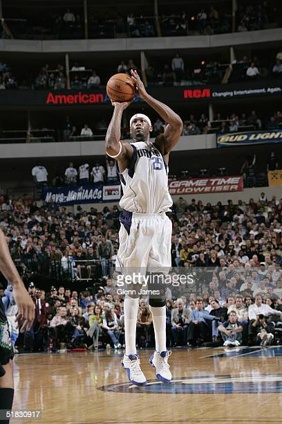 Erick Dampier of the Dallas Mavericks shoots against the Minnesota Timberwolves November 22 2004 at the American Airlines Center in Dallas Texas The...