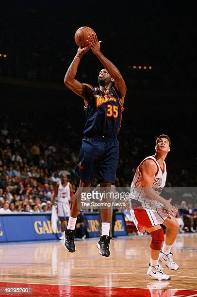 Erick Dampier of the Golden State Warriors shoots over Matt Maloney of the Houston Rockets during the game on November 22 1997 at the Compaq Center...