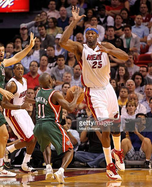 Erick Dampier of the Miami Heat guards Earl Boykins of the Milwaukee Bucks during a game at American Airlines Arena on January 4 2011 in Miami...