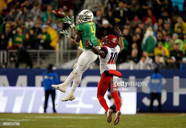 Erick Dargan of the Oregon Ducks intercepts a pass intended for Samajie Grant of the Arizona Wildcats during the PAC12 Championships at Levi's...