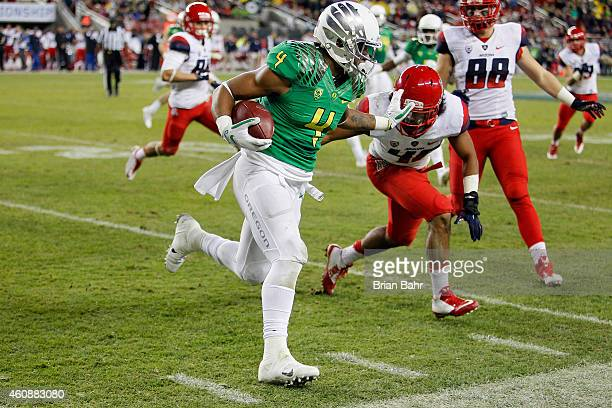 Erick Dargan of the Oregon Ducks returns a punt as he is pushed out of bounds by Blake Brady of the Arizona Wildcats in the fourth quarter on...