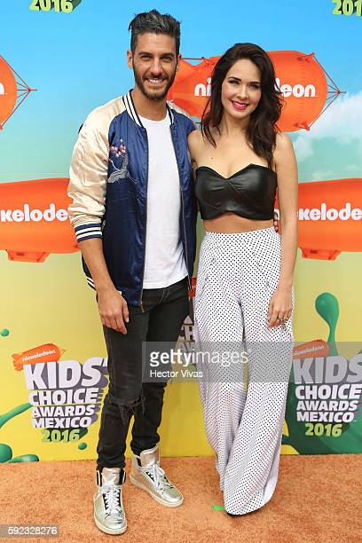 Erick Elias and Adriana Louvier pose during the Orange Carpet of the Kids Choice Awards 2016 at Auditorio Nacional on August 20, 2016 in Mexico City,...