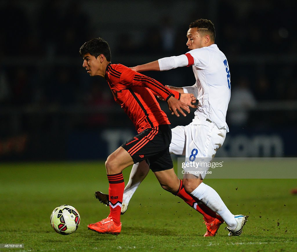 Erick Gabriel Gutierrez Galaviz of Mexico battles with Lewis Baker of England during the U20 International Friendly match between England and Mexico at The Hive on March 25, 2015 in Barnet, England.