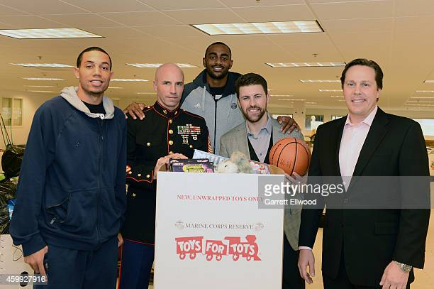 Erick Green and Darrell Arthur of the Denver Nuggets take part in the NBA Hoops for Troops Season of Givinq initiative by joining Marine Corps...