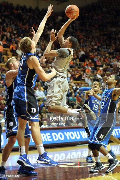 Erick Green of the Virginia Tech Hokies puts up a shot against Mason Plumlee and Alex Murphy of the Duke Blue Devils at Cassell Coliseum on February...