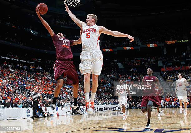 Erick Green of the Virginia Tech Hokies shoots against Tanner Smith of the Clemson Tigers in the second half of their first round game of 2012 ACC...