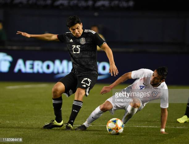 Erick Guitierrez, left, of Mexico fights for the ball with Maurcio Isla of Chile during the International Friendly match between Mexico and Chile at...