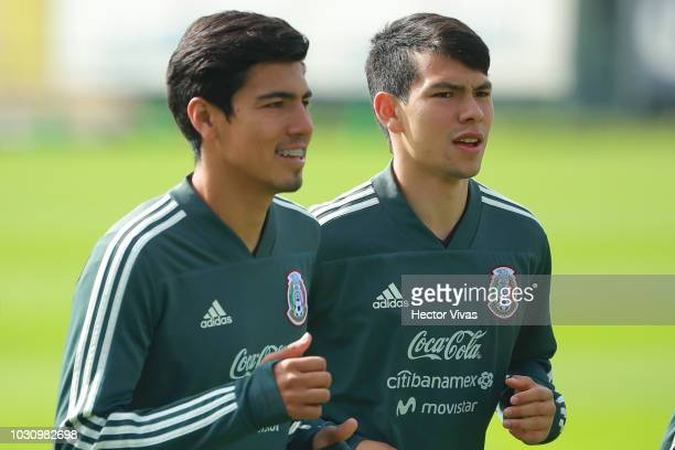 Erick Gutierrez and Hirving Lozano warm up during Mexico National Team training session ahead of the international friendly match against Uruguay at...