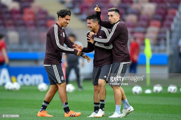 Erick Gutierrez Hirving Lozano and Hector Herrera of Mexico interact during Match Day 1 Training Session and Press Confrence at Luzhniki Stadium on...