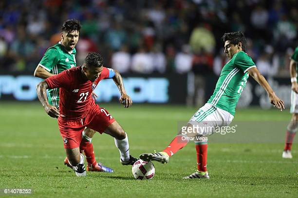 Erick Gutierrez of Mexico fights for the ball with Amilcar Henriquez of Panama during the International Friendly Match between Mexico and Panama at...