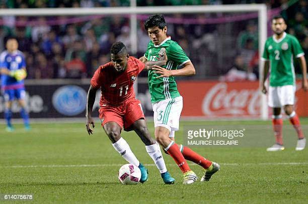 Erick Gutierrez of Mexico vies for the ball with Armando Cooper of Panama during the friendly football match between the Mexican national team and...