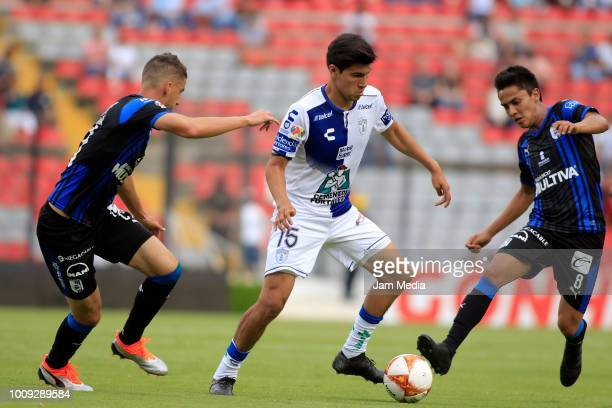 Erick Gutierrez of Pachuca fights for the ball with Aldo Arellano of Queretaro during the second round match between Queretaro and Pachuca as part of...