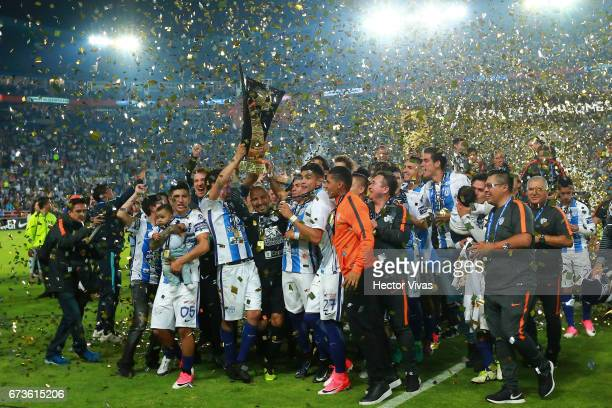 Erick Gutierrez of Pachuca lifts the trophy to celebrate with teammates after winning the Final second leg match between Pachuca and Tigres UANL as...
