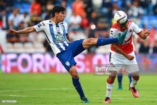 Erick Gutierrez of Pachuca struggles for the ball with Luis Martinez of Veracruz during the sixth round match between Pachuca and Veracruz as part of...