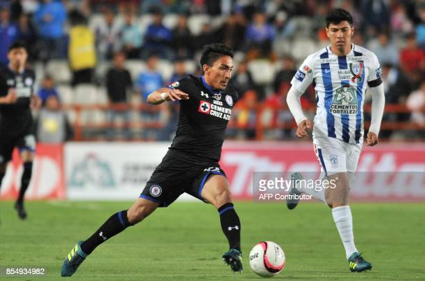 Erick Gutierrez of Pachuca vies for the ball with Angel Mena of Cruz Azul during their Mexican Apertura tournament football match at the Hidalgo...