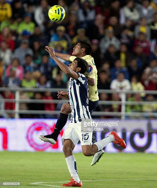 Erick Gutierrez of Pachuca vies for the ball with Osvaldo Martinez of America during their Mexican Clausura tournament football match at the Hidalgo...