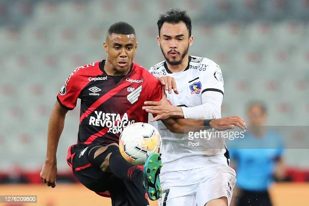 Erick of Athletico Paranaense fights for the ball with Gabriel Suazo of ColoColo during a group C match of Copa CONMEBOL Libertadores 2020 between...