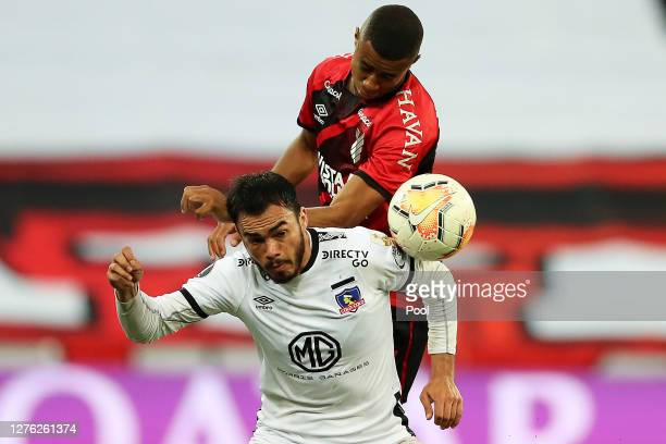 Erick of Athletico Paranaense jumps for a header with Gabriel Suazo of ColoColo during a group C match of Copa CONMEBOL Libertadores 2020 between...