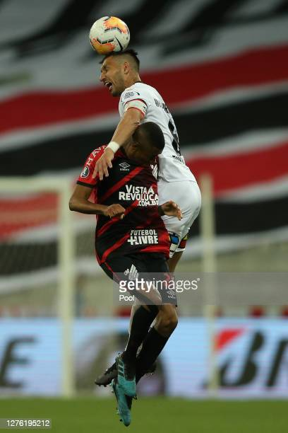 Erick of Athletico Paranaense jumps for a header witht Juan Manuel Insaurralde of ColoColo during a group C match of Copa CONMEBOL Libertadores 2020...