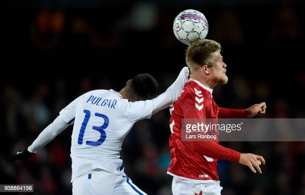 Erick Pulgar of Chile and Andreas Cornelius of Denmark compete for the ball during the International friendly match between Denmark and Chile at...