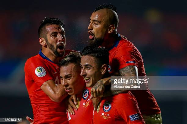 Erick Pulgar of Chile celebrates with teammates after scoring the first goal of his team during the Copa America Brazil 2019 group C match between...