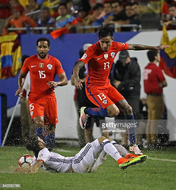 Erick Pulgar of Chile leaps over Sebastian Perez of Colombia during a semifinal match in the 2016 Copa America Centernario at Soldier Field on June...